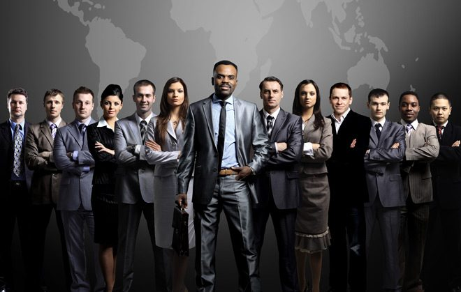 Business people standing in a group against an Earth background